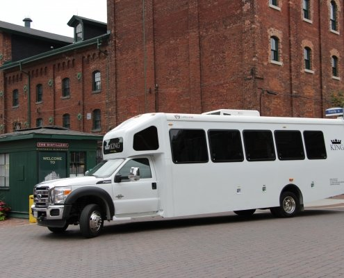 White Niagara Falls Tour bus outside the distillery district